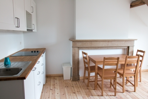 Entry with kitchen and dining table