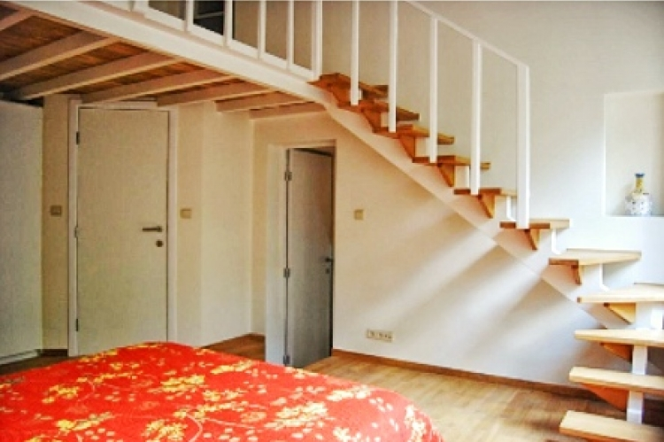 Separate mezzanine in the bedroom for an office or dressing area