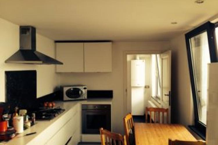 kitchen with oven, microwave, dishwasher, washing machine