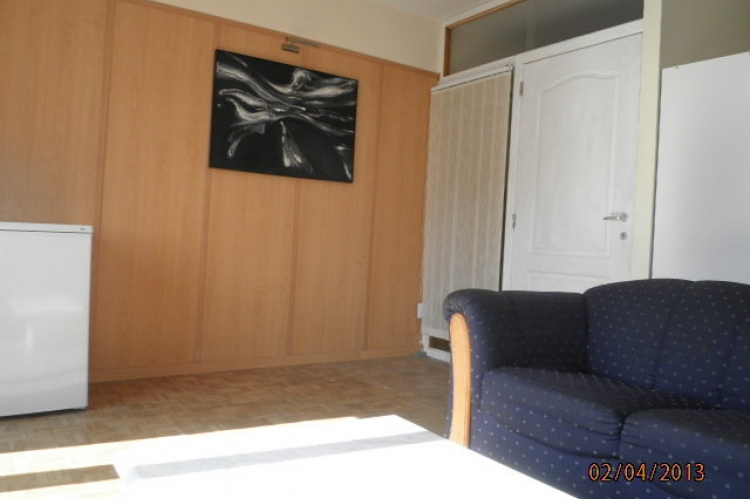 Site 1: Room 1 with sofa and personal fridge